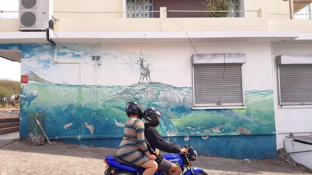 Street Art Mural of a Goat riding a Whale