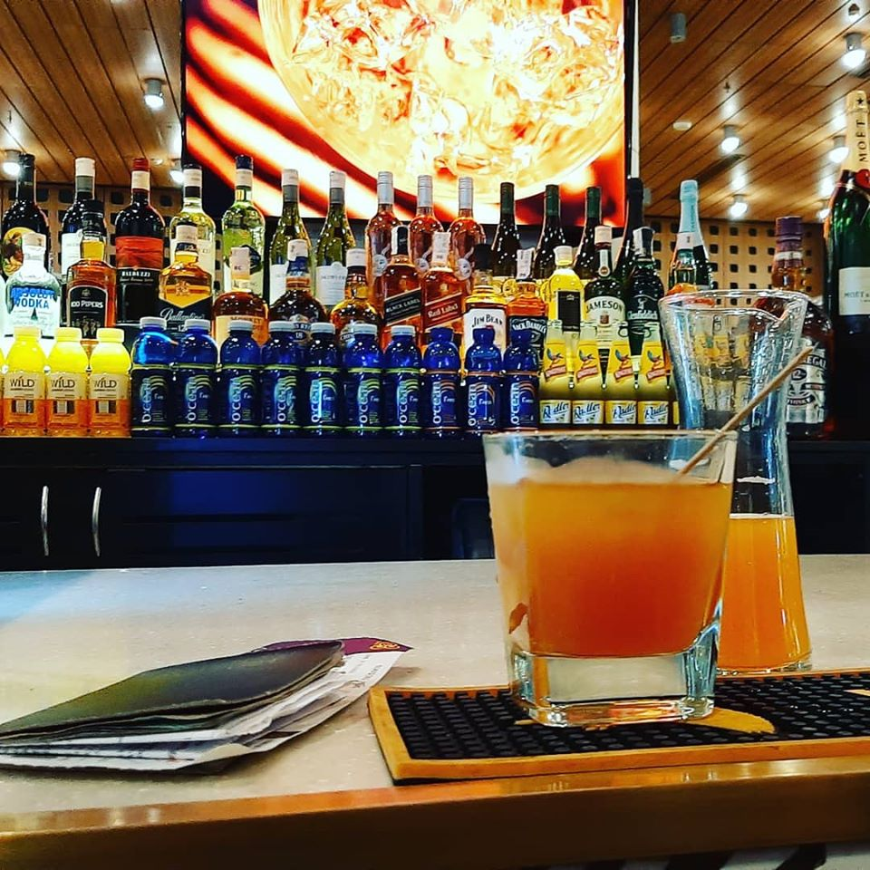 Orange Juice Rum at the Airport Bar